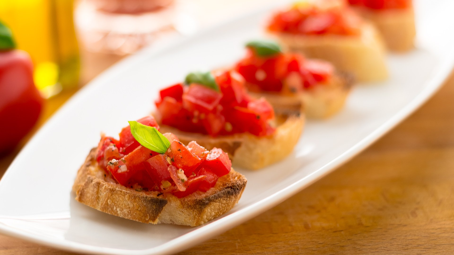 Bruschetta pronounced broo skayt tah is a simple dish with fresh ...